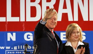 In this Oct. 26, 2006, file photo, Former President Bill Clinton and Kirsten Gillibrand, a Democratic lawyer who is running against three-term Rep. John Sweeney, R-N.Y., acknowledge the crowd at a rally in Albany, N.Y. U.S. Sen. Kirsten Gillibrand said, in an interview in The New York Times, that former President Clinton should have resigned over his sexual affair with White House intern Monica Lewinsky 20 years ago.  (AP Photo/Jim McKnight, File)