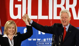 In this Oct. 26, 2006, file photo, former President Bill Clinton holds up the hand of Kirsten Gillibrand, a Democratic lawyer who was running against three-term Rep. John Sweeney, R-N.Y., at a rally in Albany, N.Y. U.S. Sen. Kirsten Gillibrand said, in an interview in The New York Times, that former President Clinton should have resigned over his sexual affair with White House intern Monica Lewinsky 20 years ago.  (AP Photo/Jim McKnight, File)