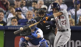 FILE - In this Oct. 25, 2017, file photo, Houston Astros' Jose Altuve hits a home run against the Los Angeles Dodgers during the 10th inning of Game 2 of baseball's World Series in Los Angeles. Houston dynamo Jose Altuve and Yankees slugger Aaron Judge are the favorites for the AL MVP award while Miami masher is the top candidate for the NL prize. (AP Photo/Mark J. Terrill, File) **FILE**