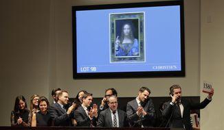 "Bidding representatives react after Leonardo da Vinci's ""Salvator Mundi"" sold for $450 million at Christie's, Wednesday, Nov. 15, 2017, in New York. (AP Photo/Julie Jacobson)"