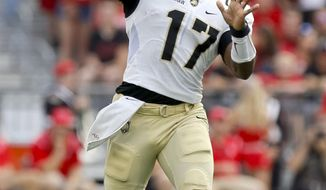 FILE - This Saturday, Sept. 16, 2017, file photo shows Army quarterback Ahmad Bradshaw throwing a pass during an NCAA college football game against Ohio State in Columbus, Ohio. Bradshaw has already endeared himself to the West Point community by leading the Black Knights to victory over Navy a year ago. (AP Photo/Jay LaPrete, File)