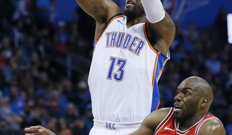 Oklahoma City Thunder forward Paul George (13) shoots in front of Chicago Bulls guard Quincy Pondexter, right, in the third quarter of an NBA basketball game in Oklahoma City, Wednesday, Nov. 15, 2017. Oklahoma City won 92-79. (AP Photo/Sue Ogrocki)