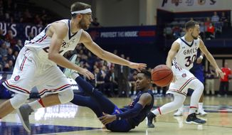 Saint Mary's Calvin Hermanson, left, drives the ball past Cal State Fullerton's Khalil Ahmad, center, during the first half of an NCAA college basketball game Wednesday, Nov. 15, 2017, in Moraga, Calif. At right is Saint Mary's Jordan Ford. (AP Photo/Ben Margot)