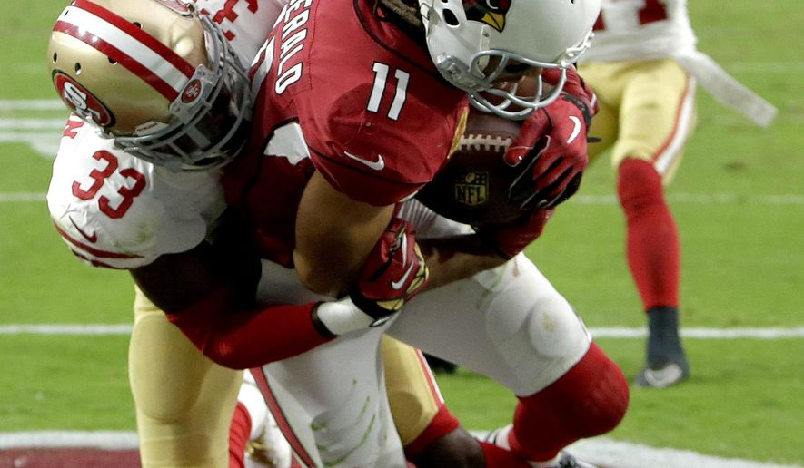 FILE -In this Oct. 1, 2017, file photo, Arizona Cardinals wide receiver Larry Fitzgerald (11) pulls in the game winning touchdown as San Francisco 49ers cornerback Rashard Robinson (33) defends during overtime of an NFL football gamevin Glendale, Ariz. At age 34, Fitzgerald is tied for second in the NFL in receptions this season with 60, one fewer than Jarvis Landry. He's caught a pass in 204 consecutive games. (AP Photo/Rick Scuteri, File)