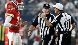 FILE - In this Sunday, Nov. 5, 2017, file photo, Kansas City Chiefs quarterback Alex Smith (11) argues a call with side judge Laird Hayes (125) and referee Pete Morelli (135) during an NFL football game against the Dallas Cowboys in Arlington, Texas. The Chiefs hope a week off can serve as a reset to their season. They began 5-0 before losing three of their last four, and quarterback Alex Smith even threw an interception in a loss to Dallas just before the bye. (AP Photo/Brandon Wade, File)