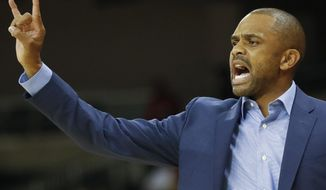 Coppin State coach Juan Dixon gestures to players during the first half of an NCAA college basketball game against Cincinnati, Thursday, Nov. 16, 2017, in Cincinnati. (AP Photo/John Minchillo)