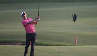 England's Justin Rose follows his ball on the 18th hole during the first round of the DP World Tour Championship golf tournament in Dubai, United Arab Emirates, Thursday, Nov. 16, 2017. (AP Photo/Kamran Jebreili)