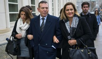 Juan Angel Napout, center, arrives at federal court in the Brooklyn borough of New York, Thursday, Nov. 16, 2017.  Napout, Manuel Burga, and Juan Angel Napout have pleaded not guilty to charges they took part in a 24-year scheme involving at least $150 million in bribes that secured tournament broadcasting and hosting rights in the sprawling FIFA scandal. (AP Photo/Craig Ruttle)