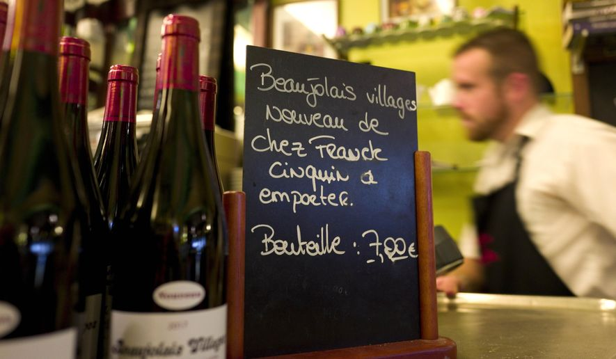 The annual release of Beaujolais Nouveau is a sign that Thanksgiving is near, and D.C. area chefs are preparing with some traditional and not-so-traditional dishes. (Associated Press/File)