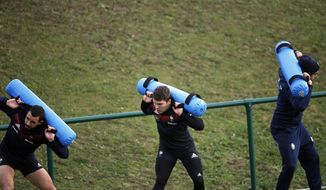 France's Geoffrey Doumayrou, left, Antoine Dupont, centre, and Yoann Huget practise during a training session at the National Rugby Center in Marcoussis, south of Paris, Thursday, Nov. 16, 2017. France will play against South Africa during their international rugby match on Saturday, Nov. 18. (AP Photo/Christophe Ena)