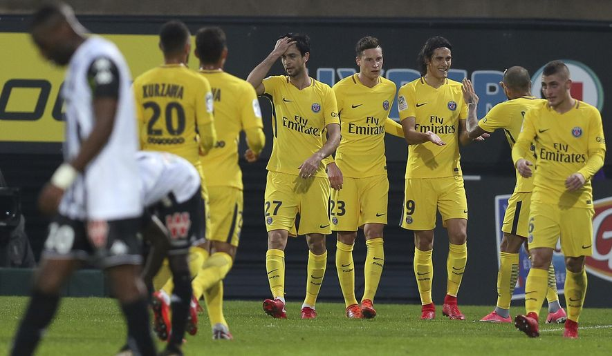 Paris Saint Germain's forward Edinson Cavani of Uruguay, third right, celebrates with teammates after scoring the second goal during his French League One soccer match against Angers, Saturday, Nov. 4, 2017, in Angers, western France. (AP Photo/David Vincent)