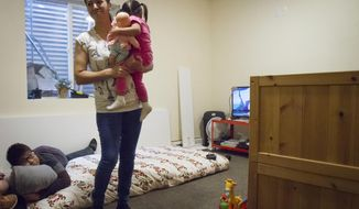 ADVANCE FOR WEEKEND EDITIONS, NOV 18 -19 -  In this Saturday, Nov. 11, 2017 photo, Sandra Lopez and her 2-year-old daughter Areli play together in their small basement apartment in a parsonage in Carbondale, Colo. Lopez, a 42-year-old woman who has taken sanctuary against deportation in a Carbondale parsonage, came to the U.S. nearly 20 years ago, running away from the violence, government corruption and poverty of Chihuahua, Mexico (Chelsea Self/Glenwood Springs Post Independent via AP)