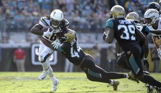 FILE - In this Nov. 12, 2017, file photo,  Jacksonville Jaguars linebacker Myles Jack (44) tackles Los Angeles Chargers running back Melvin Gordon (28)  during the first half of an NFL football game in Jacksonville, Fla.  Jacksonville plays at Cleveland on Sunday. (AP Photo/Phelan M. Ebenhack, File)
