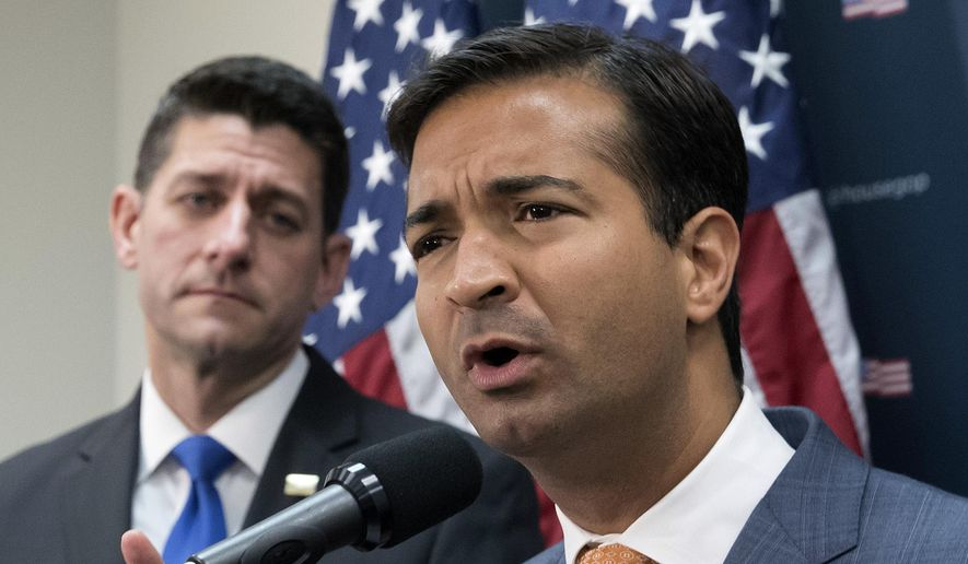 In this Oct. 24, 2017, file photo, Rep. Carlos Curbelo, R-Fla., right, stands with Speaker of the House Paul Ryan, R-Wis., left, discussing the GOP agenda for tax reform during a news conference on Capitol Hill in Washington. (AP Photo/J. Scott Applewhite, File)