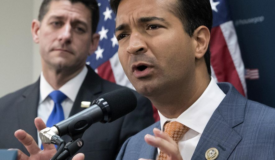 In this Oct. 24, 2017 file photo, Rep. Carlos Curbelo, R-Fla., right, stands with Speaker of the House Paul Ryan, R-Wis., left, discussing the GOP agenda for tax reform during a news conference on Capitol Hill in Washington. Mr. Curbelo has been denied membership in the Congressional Hispanic Congress, with a spokesman saying the decision was because the Florida Republican does not share the group's politically liberal values. (AP Photo/J. Scott Applewhite, File)