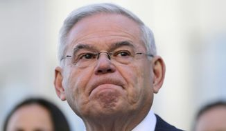 Democratic Sen. Bob Menendez becomes emotional as he speaks to reporters in front of the courthouse in Newark, N.J., Thursday, Nov. 16, 2017. The federal bribery trial of Menendez ended in a mistrial Thursday when the jury said it was hopelessly deadlocked on all charges against the New Jersey politician and a wealthy donor. (AP Photo/Seth Wenig)