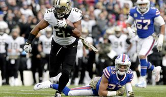 FILE - In this Nov. 12, 2017, file photo, New Orleans Saints running back Mark Ingram II (22) runs with the ball during the first half of an NFL football game against the Buffalo Bills,in Orchard Park, N.Y. As usual, Drew Brees has the passing game humming, and the contributions of the running back tandem of Mark Ingram and rookie Alvin Kamara has made New Orleans even more dynamic with the ball. The Washington Redskins play at New Orleans on Sunday. (AP Photo/Adrian Kraus, File)