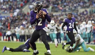 FILE - In this Dec. 4, 2016, file photo, Baltimore Ravens strong safety Eric Weddle, center, intercepts a pass in the second half of an NFL football game against the Miami Dolphins, in Baltimore. Weddle said creating turnovers was a top priority when he arrived in Baltimore after nine seasons with the Chargers. The ravens play at the Green Bay Packers on Sunday. (AP Photo/Gail Burton, File)