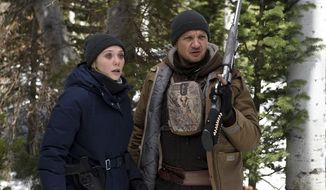 """This image released by The Weinstein Company shows Elizabeth Olsen, left, and Jeremy Renner in a scene from """"Wind River."""" Writer and director Taylor Sheridan has not only taken his film """"Wind River"""" out of the hands of Harvey Weinstein and the company bearing his name, but is trying to wrest some good out of it too. The film deals with sexual violence against women on an Indian Reservation and he did not want any further association with an alleged sexual harasser. (Fred Hayes/The Weinstein Company via AP)"""
