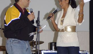 In this image provided by the U.S. Army, then-comedian Al Franken and sports commentator Leeann Tweeden perform a comic skit at Forward Operating Base Marez in Mosul, Iraq, on Dec. 16, 2006, during the USO Sergeant Major of the Army's 2006 Hope and Freedom Tour. Sen. Al Franken, D-Minn., apologized Nov. 16, 2017, after Tweeden accused him of forcibly kissing her during the 2006 USO tour. Colleagues, including fellow Democrats, urged a Senate ethics investigation. Tweeden also accused Franken of posing for a photo with his hands on her breasts as she slept, while both were performing for military personnel two years before the one-time comedian was elected to the Senate. (Creighton Holub/U.S. Army via AP)