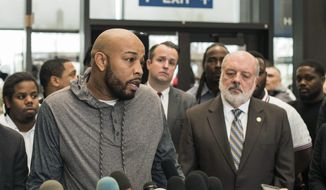 Leonard Gipson, one of 15 convicted men, talks to reporters after a judge in Chicago threw out the convictions of the men, who say a corrupt Chicago police sergeant manufactured evidence that sent them to prison, Thursday, Nov. 16, 2017, in Chicago. Cook County prosecutors made the request Thursday as 10 of the men stood before Judge Leroy Martin Jr. It was the latest chapter in a scandal that resulted in former Sgt. Ronald Watts' 2013 conviction for extorting money from drug dealers. (Max Herman /Chicago Sun-Times via AP)