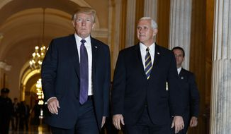 President Donald Trump and Vice President Mike Pence leave Capitol Hill after meeting with lawmakers on tax policy, Thursday, Nov. 16, 2017, in Washington. (AP Photo/Evan Vucci)