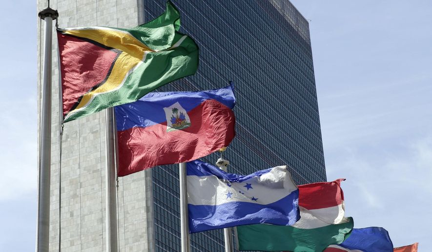 In this June 1, 2016, file photo, flags of some of the 193 countries fly in the breeze in front of the Secretariat building of the United Nations. (AP Photo/Richard Drew, File) **FILE**