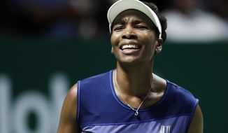 FILE - In this Oct. 28, 2017, file photo, Venus Williams, of the United States, reacts after conceding a point to Caroline Garcia, of France, during their semifinal match at the WTA tennis tournament in Singapore. Burglars hit the tennis star's Florida home, stealing $400,000 worth of goods while she was at the U.S. Open. Palm Beach Gardens police released a report Thursday, Nov. 16, 2017, about the burglary, which happened between Sept. 1 and 5. (AP Photo/Yong Teck Lim, File)