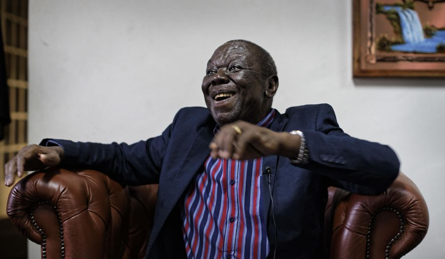 Zimbabwe opposition leader Morgan Tsvangirai speaks to the Associated Press after giving a press conference at his home in Harare, Zimbabwe, Thursday, Nov. 16, 2017.  Tsvangirai said President Robert Mugabe must resign and called for a negotiated, inclusive transitional mechanism as well as comprehensive reforms before elections. (AP Photo/Ben Curtis)