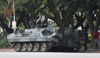 A military tank is seen on a street in Harare, Zimbabwe, Thursday, Nov. 16, 2017. People across the country are starting another day of uncertainty amid quiet talks to resolve the country's political turmoil and the likely end of President Robert Mugabe's decades-long rule. Mugabe has been in military custody and there is no sign of the recently fired deputy Emmerson Mnangagwa, who fled the country last week. (AP Photo)