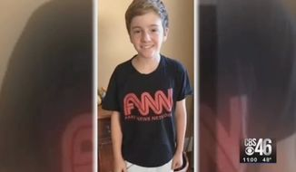 "A Georgia county commissioner and her school board member husband are crying foul after their seventh-grade son was ordered to change out of his ""FNN - Fake News Network"" T-shirt before going on a school field trip to CNN's Atlanta headquarters. (WGCL)"