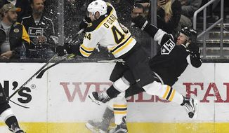Boston Bruins defenseman Rob O'Gara, left, collides with Los Angeles Kings left wing Tanner Pearson during the first period of an NHL hockey game, Thursday, Nov. 16, 2017, in Los Angeles. (AP Photo/Mark J. Terrill)