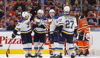 St. Louis Blues' Jaden Schwartz (17), Alexander Steen (20), Vladimir Tarasenko (91) and Alex Pietrangelo (27) celebrate a goal as Edmonton Oilers' Darnell Nurse (25) skates by during second period NHL action in Edmonton, Alberta, on Thursday, Nov. 16, 2017. (Jason Franson/The Canadian Press via AP)