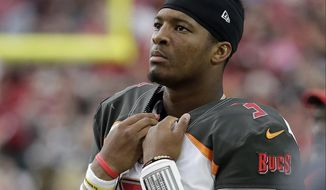 FILE - In this Sunday, Oct. 15, 2017, file photo, Tampa Bay Buccaneers quarterback Jameis Winston stands on the sidelines during the second half of an NFL football game against the Arizona Cardinals in Glendale, Ariz. Winston is being investigated for allegedly groping a female Uber driver in 2016. The Buccaneers quarterback has denied the charge on his Twitter and Instagram accounts.  (AP Photo/Rick Scuteri, File)