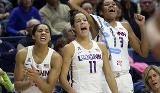 Connecticut's Gabby Williams (15), Kia Nurse (11) and Azura Stevens (23) react at the end of an NCAA college basketball game against California, Friday, Nov. 17, 2017, in Storrs, Conn. (AP Photo/Stephen Dunn)