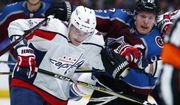 Colorado Avalanche left wing Gabriel Landeskog, right, of Sweden, vies for position with Washington Capitals defenseman Dmitry Orlov, of Russia, during the third period of an NHL hockey game Thursday, Nov. 16, 2017, in Denver. Colorado won 6-2. (AP Photo/David Zalubowski)