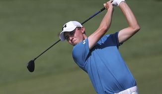 Matthew Fitzpatrick from England plays a shot on the 2nd hole during the second round of the DP World Tour Championship golf tournament in Dubai, United Arab Emirates, Friday, Nov. 17, 2017. (AP Photo/Kamran Jebreili)