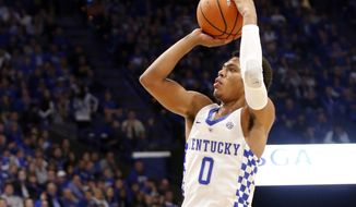 Kentucky's Quade Green (0) takes an uncontested shot during the first half of an NCAA college basketball game against East Tennessee State, Friday, Nov. 17, 2017, in Lexington, Ky. (AP Photo/James Crisp)