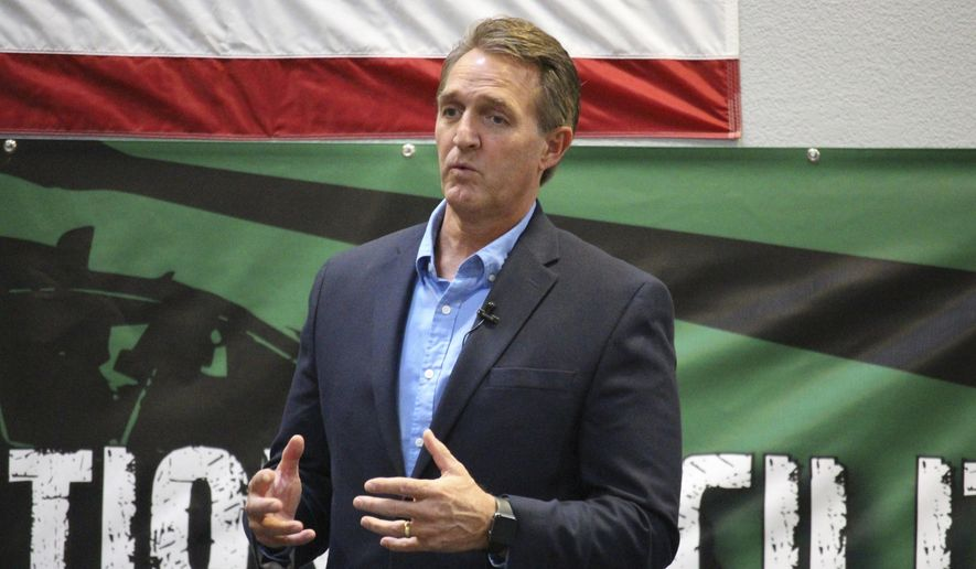 Sen. Jeff Flake, R-Ariz., speaks to aerospace workers about the current congressional tax reform proposal in Mesa, Ariz., Friday, Nov. 17, 2017. Flake told aerospace company workers that corporate tax cuts are needed to restore America's global competitiveness. (AP Photo/Bob Christie) ** FILE **