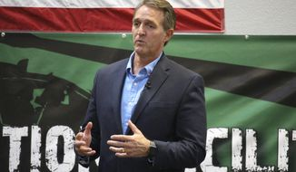 Sen. Jeff Flake, R-Ariz., speaks to aerospace workers about the current congressional tax reform proposal in Mesa, Ariz., Friday, Nov. 17, 2017. Flake told aerospace company workers that corporate tax cuts are needed to restore America's global competitiveness. (AP Photo/Bob Christie)