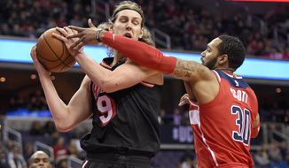 Washington Wizards forward Mike Scott (30) battles for the ball against Miami Heat center Kelly Olynyk (9) during the first half of an NBA basketball game, Friday, Nov. 17, 2017, in Washington. (AP Photo/Nick Wass)
