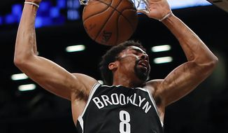 Brooklyn Nets guard Spencer Dinwiddie dunks the ball against the Utah Jazz during the second quarter of an NBA basketball game, Friday, Nov. 17, 2017, in New York. (AP Photo/Julie Jacobson)
