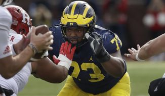 FILE - In this Oct. 28, 2017, file photo, Michigan defensive lineman Maurice Hurst (73) goes up against the Rutgers line during the first half of an NCAA college football game in Ann Arbor, Mich. No. 5 Wisconsin will face its sternest test yet this season when No. 19 Michigan visits Camp Randall Stadium in the home season finale. (AP Photo/Carlos Osorio, File)