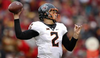 Oklahoma State quarterback Mason Rudolph throws a pass during the second half of an NCAA college football game against Iowa State, Saturday, Nov. 11, 2017, in Ames, Iowa. Oklahoma State won 49-42. (AP Photo/Charlie Neibergall)
