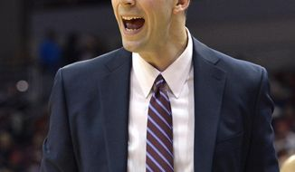 Louisville interim head coach David Padgett shouts instructions to his team during the first half of an NCAA college basketball game against Omaha, Friday, Nov. 17, 2017, in Louisville, Ky. (AP Photo/Timothy D. Easley)