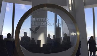 A giant snow globe designed for selfies is displayed at One World Observatory in Lower Manhattan, Friday, Nov. 17, 2017, in New York. The snow globe is part of a holiday makeover for the observatory atop One World Trade. The experience is called Winter ONEderland.  (AP Photo/Beth Harpaz)