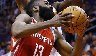 Houston Rockets guard James Harden (13) slips past Phoenix Suns forward Josh Jackson, back, to get off a shot during the first half of an NBA basketball game Thursday, Nov. 16, 2017, in Phoenix. (AP Photo/Ross D. Franklin)