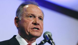 Former Alabama Chief Justice and U.S. Senate candidate Roy Moore speaks at a news conference, Thursday, Nov. 16, 2017, in Birmingham, Ala. (AP Photo/Brynn Anderson) ** FILE **