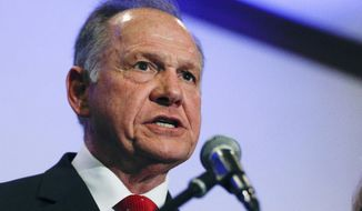 Former Alabama Chief Justice and U.S. Senate candidate Roy Moore speaks at a news conference, Thursday, Nov. 16, 2017, in Birmingham, Ala. The normally sleepy Senate Ethics Committee hasn't had a major case since 2011, but it could be deciding next year on the fate of three senators _ including two facing allegations of inappropriate sexual behavior.  (AP Photo/Brynn Anderson)