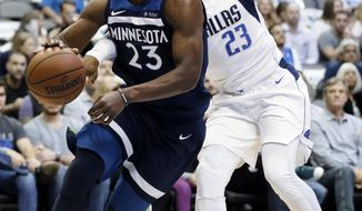 Minnesota Timberwolves guard Jimmy Butler (23) gets past Dallas Mavericks' Wesley Matthews, right, on a drive to the basket in the first half of an NBA basketball game, Friday, Nov. 17, 2017, in Dallas. (AP Photo/Tony Gutierrez)